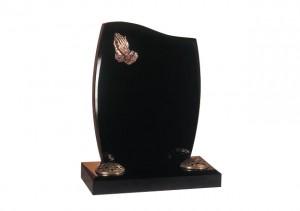 Black granite headstone with praying hands ornamentation