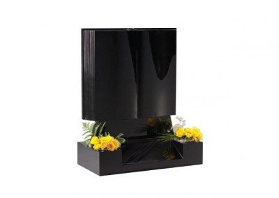 Black granite book headstone with centre splay base