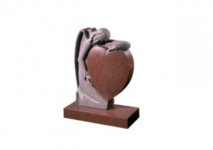 Ruby Red granite memorial with hand carved angel holding a heart
