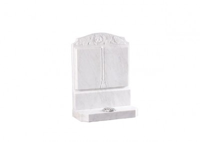 Marble headstone with carved rose and dove design