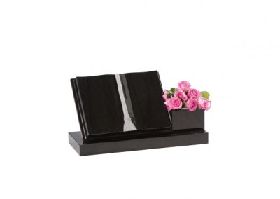 Black granite book featuring a side vase