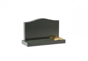 Dark grey granite ogee shaped headstone with flower container