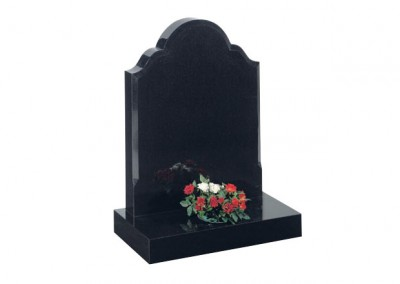 Black granite headstone with chamfered sides