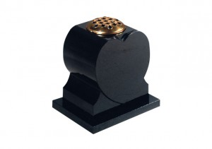 Black granite memorial vase worked into a heart shape.