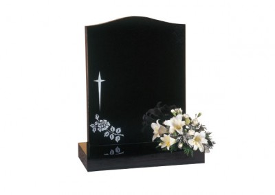 Black granite headstone with star cross and rose design