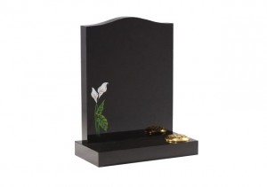 Black granite headstone with etched and painted lily