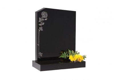 Black granite headstone with peon top with etched single climbing rose ornament