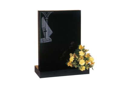 Black granite headstone with etched church window design