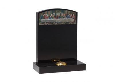 Black granite headstone with etched and painted 'Last supper' design