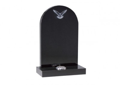 Black granite headstone with etched dove design and rounded top