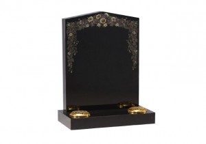 Black granite headstone with etched and painted wild flower design