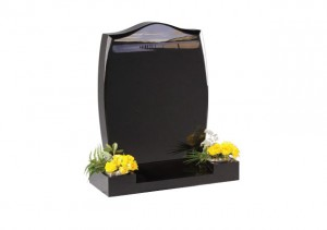 Black granite headstone with chamfered headstone and centre splay base