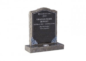 Blue Pearl granite memorial with hand carved roses and pitched edges