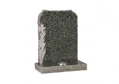 Ocean Green granite headstone with carved daffodil design and pitched sides