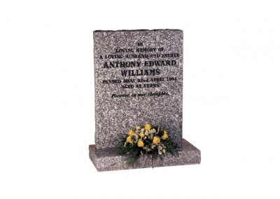 Mervyn Grey granite headstone with natural pitched edges with black painted inscription