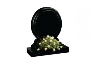 Black granite round headstone with rounded chamfers