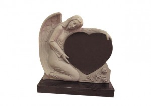 lack granite headstone with carved angel cradling a heart