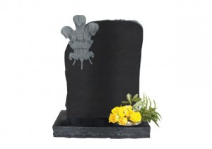 Black granite headstone with deep carved three feathers.